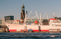 Hamburg, view from the south. Hamburg, Germany, viewed from the riverside on the south of the river Elbe. The famous ship Cap San Diego and the church St royalty free stock images