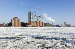Hamburg HafenCity Elbphilharmonie construction. Elbphilharmonie construction site and Hamburg HafenCity, frozen Elbe river in foreground Royalty Free Stock Photo