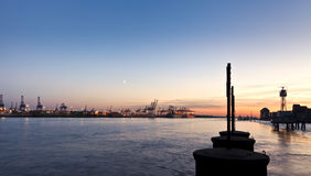 Hamburg Harbor at Dusk. Panoramic view of Hamburg harbor on the Elbe river at sunset Royalty Free Stock Image