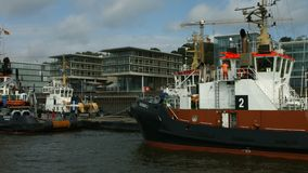 Hamburg harbour. Passing several towboats in Hamburg harbour on a bright and sunny morning stock video footage