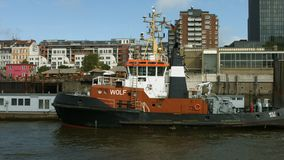 Hamburg harbour. Passing a towboat in Hamburg harbour on a bright and sunny morning stock video