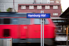 Hamburg Hauptbahnhof. The city's central train station. Train from Deutsche Bahn with motion blur passing in background. Note, slight grain Stock Photo