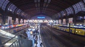 Hamburg Hauptbahnhof - central railway station in Hamburg, Germany. HAMBURG, GERMANY - NOVEMBER 12, 2013: Passengers waiting trains at Hamburg Central railway stock footage