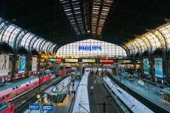 Hamburg Hauptbahnhof railway station. Hamburg Hauptbahnhof wide interior with elevate view of trains, people traveling and huge Philips advertisement. It is one royalty free stock photo