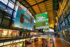 Hamburg Hauptbahnhof railway station. Hamburg Hauptbahnhof wide interior with elevate view of trains, people traveling and huge Philips advertisement. It is one stock photography