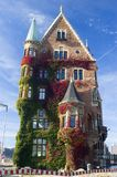 Hamburg historic house in fall. Victorian house in Hamburg Germany with ivy covered walls shot against a blue sky Stock Photos