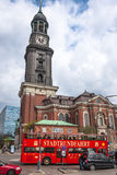 Hamburg Hop-on Hop-off Tour bus and the St. Michael's Church Stock Photography
