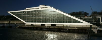 Hamburg Office Building. The Dockland Office Building located in the Elbe River near the Hamburg port is shaped like a ship Stock Images