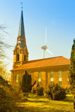 Hamburg, old church of Altenwerder and wind engine Stock Images