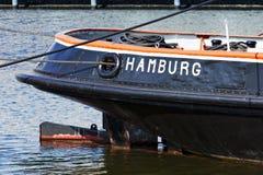 Hamburg op historische sleepboot wordt geschreven die Royalty-vrije Stock Foto's