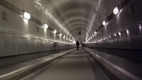 HAMBURG  People walk through the old Elbe tunnel in Hamburg Germany. Event with more than 1.5 million visitors & 300 guest ships stock footage