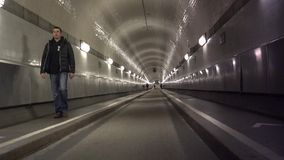 HAMBURG  People walk through the old Elbe tunnel in Hamburg Germany. Event with more than 1.5 million visitors & 300 guest ships stock video