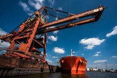 Hamburg port cargo crane royalty free stock photography