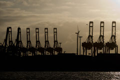 Hamburg port cranes. Hamburg port crane silhouette at sunset Stock Photography