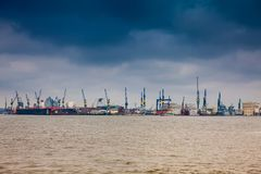 Hamburg port on a dark cloudy winter day. Hamburg port on a dark cloudy end of winter day royalty free stock photo