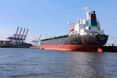 Hamburg port. HAMBURG, GERMANY - AUGUST 28, 2014: Ataman bulk carrier is loaded in Port of Hamburg. Ataman was constructed by Samsung Heavy Industries in 2001 Stock Photography