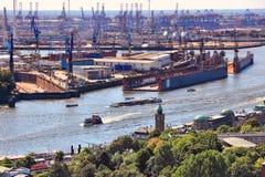 Hamburg Port. Hamburg, Germany - port seen from river Elbe. Industrial harbor cranes and dry dock Royalty Free Stock Photography
