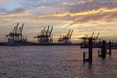 Hamburg - Port at sunset with container gantry cranes Royalty Free Stock Photography