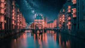 Hamburg`s Speicherstadt at night with milkyway stock photos