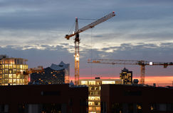 Hamburg skyline by night. Construction cranes and Philarmonie building Royalty Free Stock Images