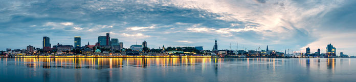 Hamburg Skyline at sunrise, Germany. Panorama of the Hamburg Skyline in Germany at sunrise during the blue hour stock image