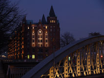 Hamburg Speicherstadt. Bridge and building at Hamburg Speicherstadt by night, Speicherstadt means old tradional ware- and stockhouses in the Hamburg harbour Stock Photo