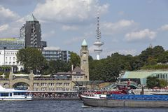 Hamburg - St. Pauli Jetties. The St. Pauli Jetties at the Harbor of Hamburg taken at bright sunlight with blue sky and white clouds on August 8, 2014 Royalty Free Stock Image