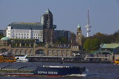 Hamburg - St. Pauli jetties and television tower with freighter Royalty Free Stock Photos