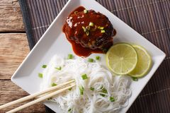 Hamburg Steak or�Hambagu  with garnish of rice vermicelli close- Royalty Free Stock Images