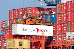 Hamburg Sud container shipping. ROTTERDAM, NETHERLANDS - MAR 16, 2016: Container from Hamburg Sud is loaded onto a ship in the Port of Rotterdam Stock Photos