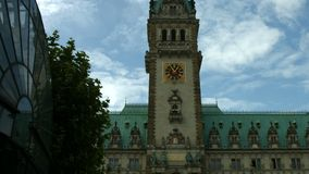 Hamburg town hall. Establishing shot of the Hamburg town hall with its historic tower and clock stock footage