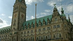 Hamburg town hall. Establishing shot of the Hamburg town hall with its historic tower and clock stock video footage