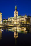 Hamburg Town Hall At Night. The famous town hall in Hamburg, Germany at night with reflection in a canal Royalty Free Stock Photography