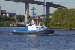 Hamburg - Tugboat under Koehlbrand Bridge Stock Photos