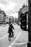 In the right lane. Hamburg is very friendship city for cyclies. Some streets have special lane for motion on bicycles and traffic lights Stock Image
