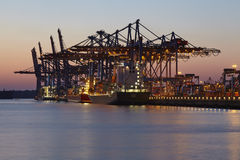 Hamburg Waltershof - Container vessel is loaded and unloaded at Burchardkai Royalty Free Stock Image