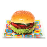 Hamburger. On glass colour plate Isolated on white background Royalty Free Stock Photos