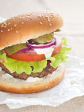 Hamburger. With cheese, meat and fresh vegetables, selective focus Royalty Free Stock Images