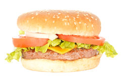 Hamburger. One hamburger with cheddar cheese, lettuce, tomato slices and onion. Isolated on white royalty free stock photos