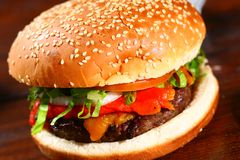 Hamburger. Delicious hamburger served ready to be eaten Royalty Free Stock Images