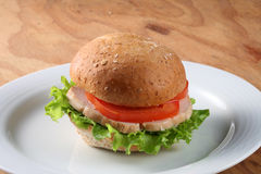 Hamburger. Burger stuffed with vegetable ham and tomato royalty free stock photography