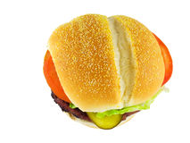 Hamburger. Fresh, hot, tasty hamburger with sesame seed bun, ground beef, pickle, lettuce, and tomato. White background stock image