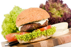 Hamburger. A juicy cheeseburger with tomato and lettuce Stock Image
