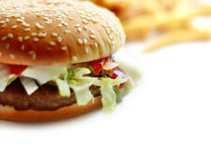 Hamburger. A Burger with some potato chips background royalty free stock photo