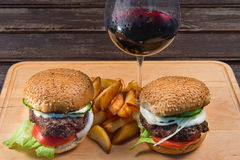 Hamburger And French Fries On A Wooden Plate. Stock Photos