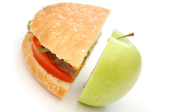 Hamburger and apple Royalty Free Stock Photos
