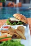 Hamburger At Hotel Pool Stock Photography
