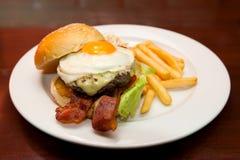 Hamburger bacon with eggs Stock Photos