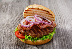 Hamburger with bacon and grilled meat Stock Photo