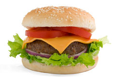 Hamburger, beef cheese tomato and red onion. Hamburger with all the trimmings on a sesame bun. With clipping path Stock Photo